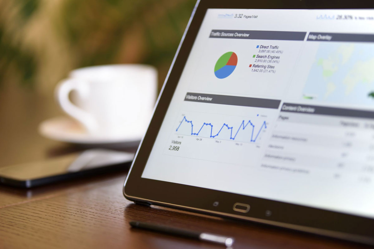 A tablet showing positive SEO performance metrics in Google Analytics